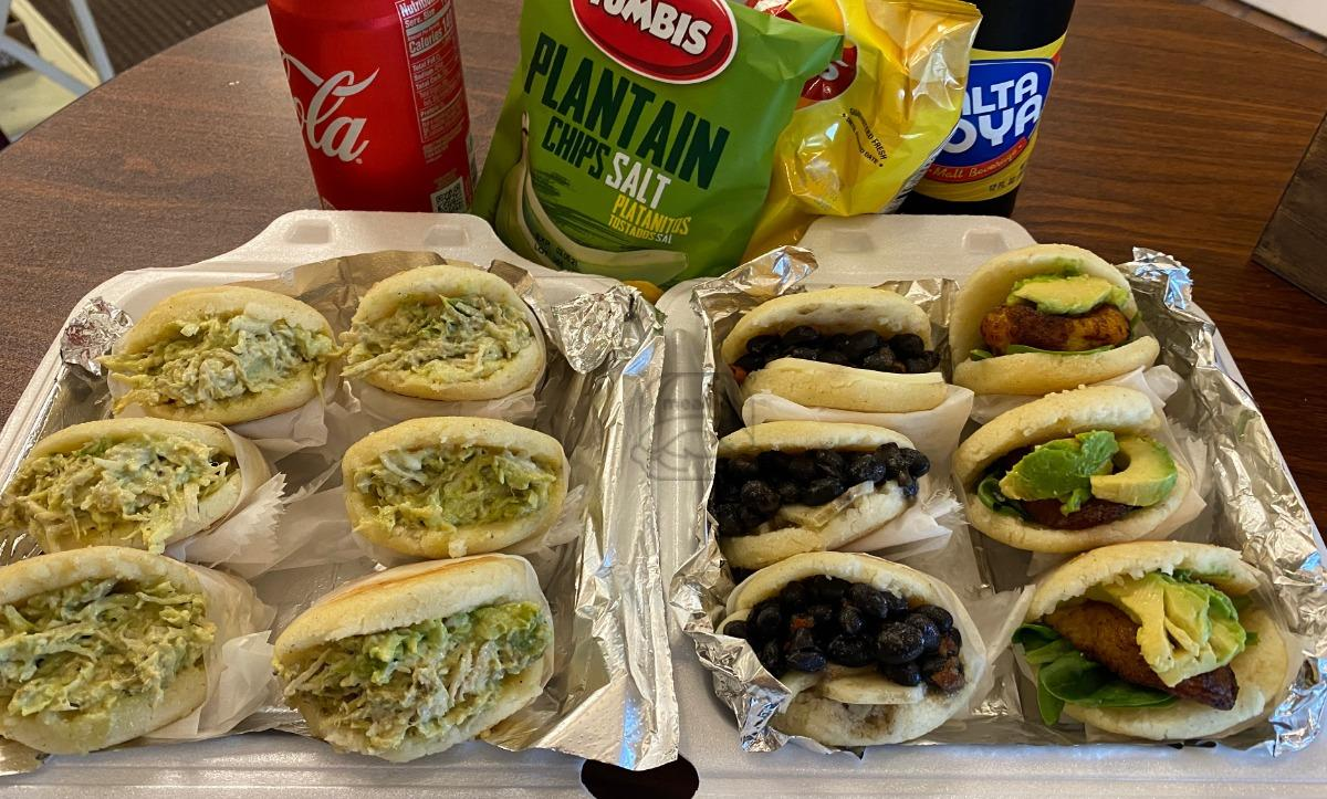 12 Assorted stuffed Arepas, chips and soda